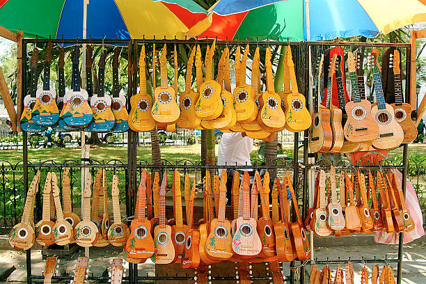a very large amount and different types of ukuleles  - cebu stockfoto's en -beelden