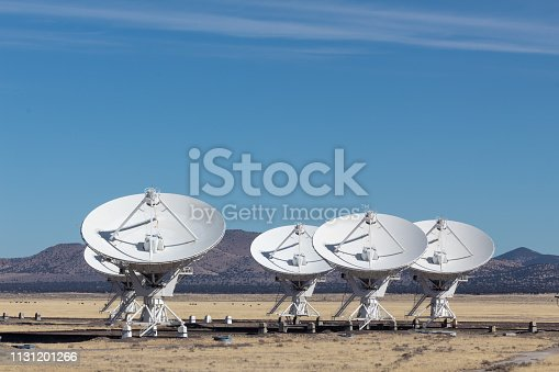 Very Large Array arrangement of radio astronomy observatory dishes, engineering science technology, copy space, horizontal aspect