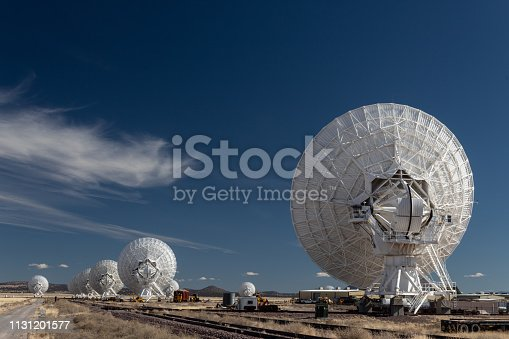 Very Large Array line of radio astronomy telescopes seen from the rear, science technology, horizontal aspect