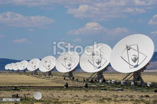 a row of satellite dishes at the Very Large Array near Socorro, New Mexico
