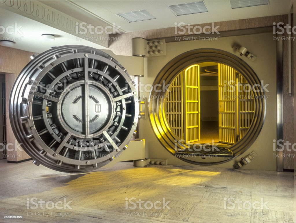 Very large Open Safe With golden  Light shining from within the safe. stock photo