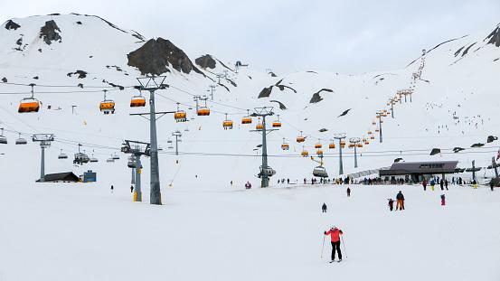 Very long chairlift in popular European ski resort in Austria