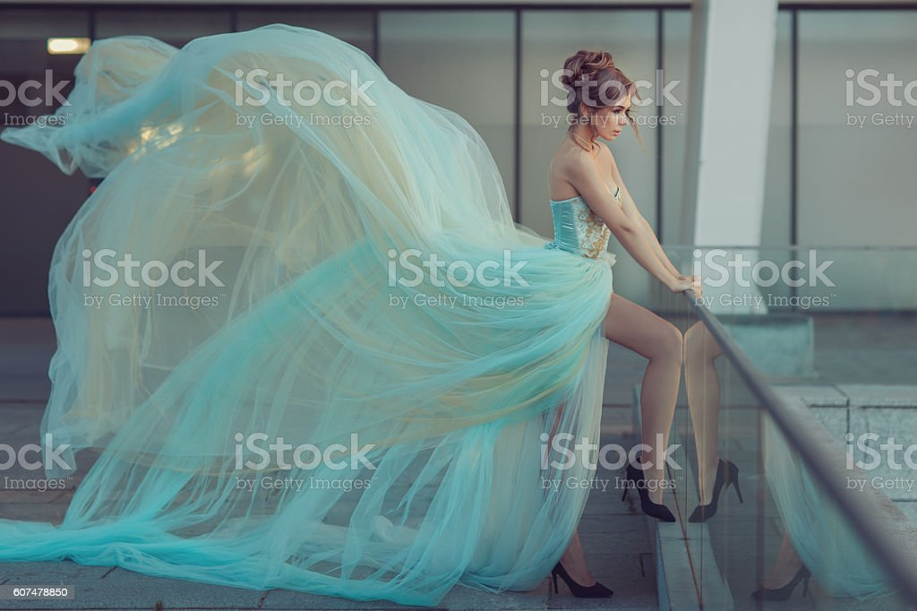 Very long dress on a girl. stock photo