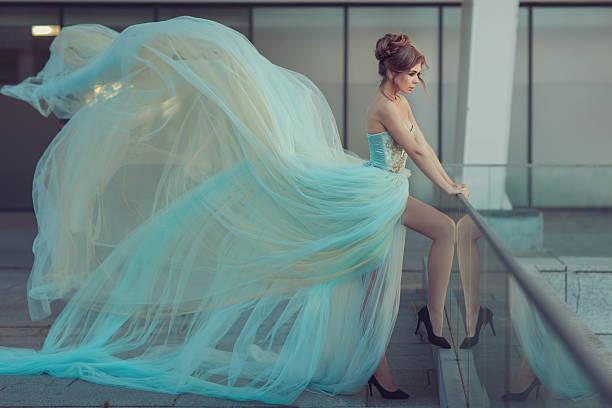 very long dress on a girl. - abendkleid lang blau stock-fotos und bilder