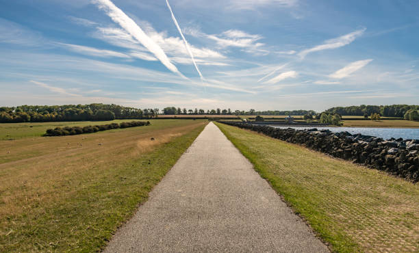 Very long footpath on edge of Rutland Water in Leicestershire stock photo