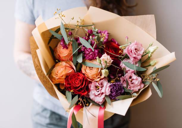Very nice young floristvwoman holding beautiful blossoming flower of picture id1084112710?b=1&k=6&m=1084112710&s=612x612&w=0&h=mb5noo4wdypi3ndasforqjyz3vxeorzaklqi8svxm2s=