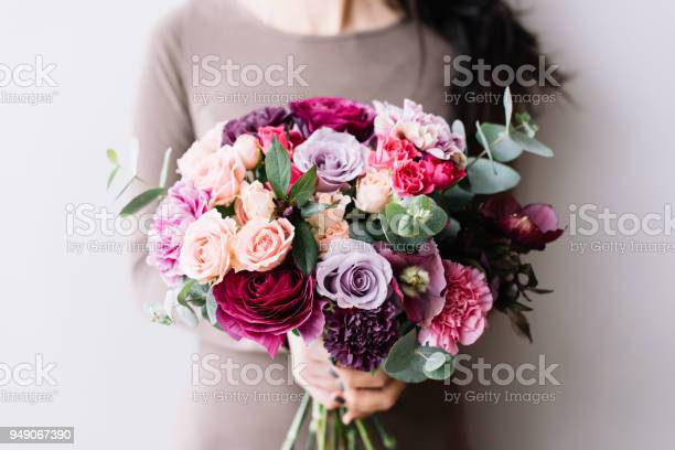 Very nice young woman holding a colourful fresh blossoming flower of picture id949067390?b=1&k=6&m=949067390&s=612x612&h=k dqpxszd1 hulr1hjcyzpd22j9 eaufvokdvc kvje=