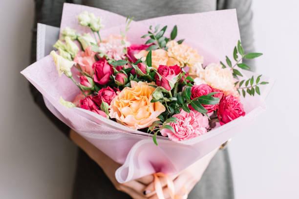 Very nice young woman holding a colourful fresh blossoming flower of picture id951105418?b=1&k=6&m=951105418&s=612x612&w=0&h=hbvrytczi8 bixptpalyj7jkn p fqijarzb5j xtq4=