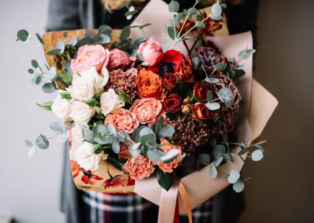 Very nice young woman holding big beautiful blossoming ombre bouquet picture id1269322891?b=1&k=6&m=1269322891&s=612x612&w=0&h=x ew46pz6w9cwvwhqmopnxnzbicjxhxbtjiu33p3qam=