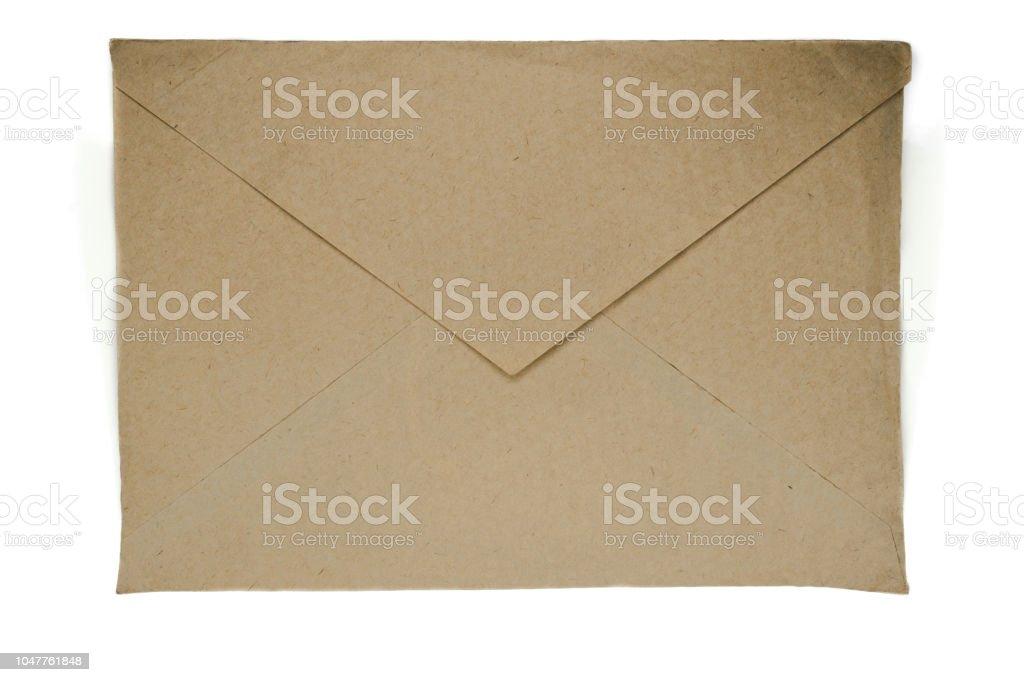 白い背景に分離された非常に古いベージュの封筒 ストックフォト