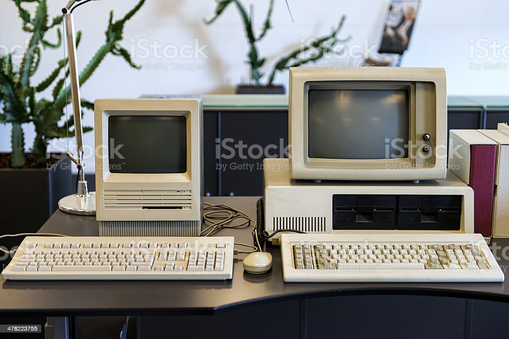 Very old computers on an office desk stock photo