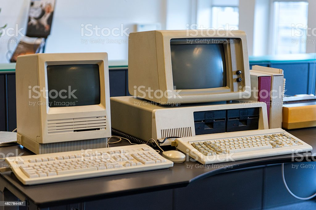 Very old computers on an office desk Two computers from the 1980s are standing on an office desk. 1980-1989 Stock Photo