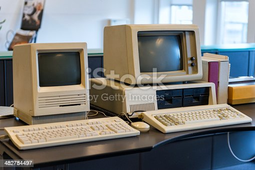 Two computers from the 1980s are standing on an office desk.