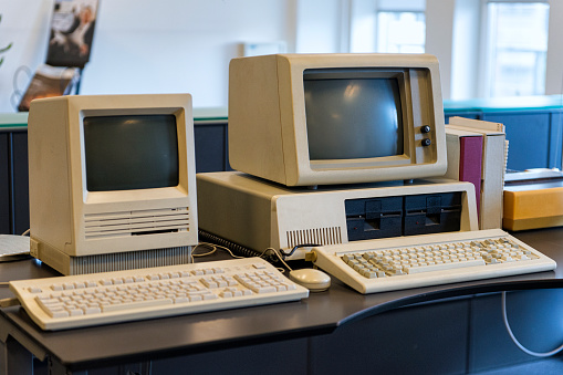 Very Old Computers On An Office Desk Stock Photo - Download Image Now