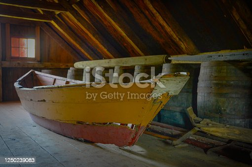 old relic small boat at the acadian village in New Brunswick, Canada. the boat sit in the loft of a farmhouse.