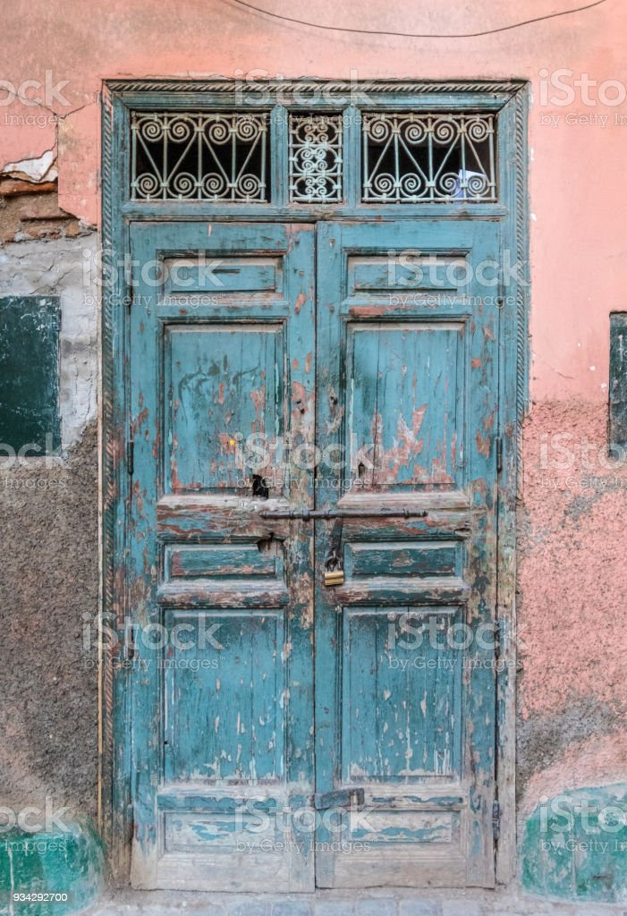Very old door and cracked wall in Medina, Marrakesh stock photo