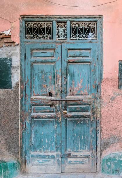 Very old door and cracked wall in Medina, Marrakesh stock photo