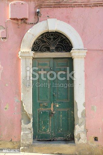 Very old door on a street in Gibraltar