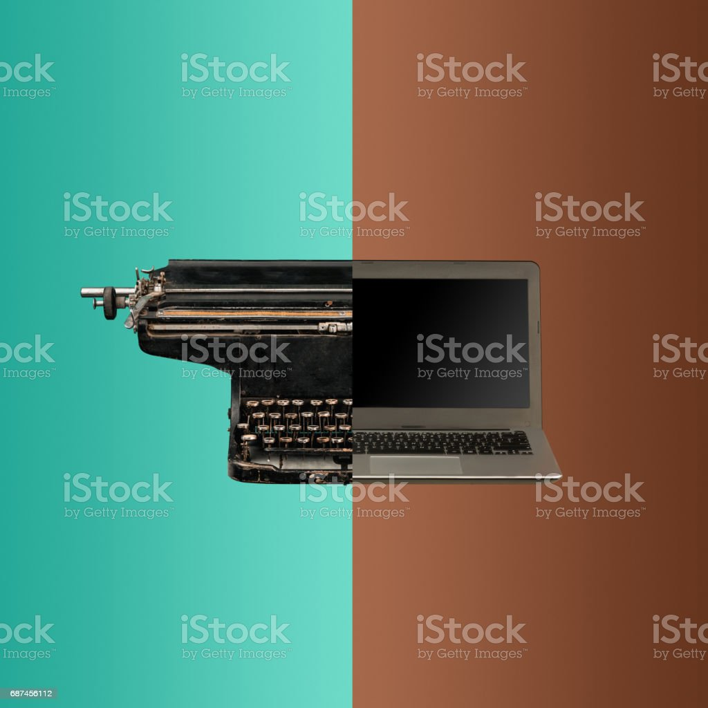 Very old fashion typewriter and laptop stock photo