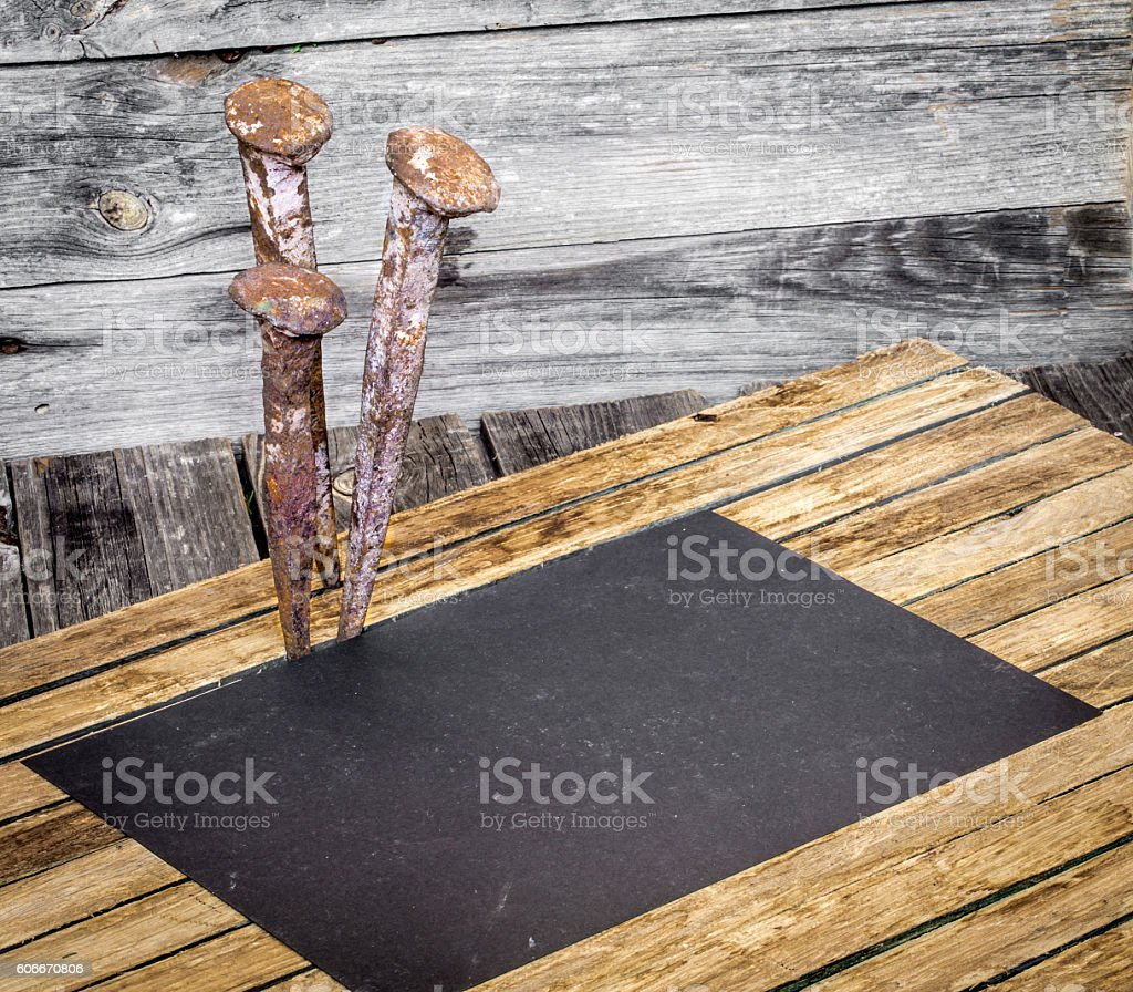 very old large nails on a beautiful wooden background, rusty stock photo