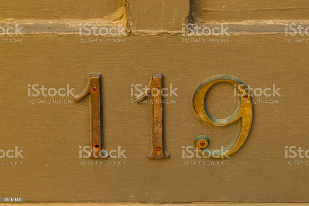 very old metal numbers on the side of a building royalty-free stock photo