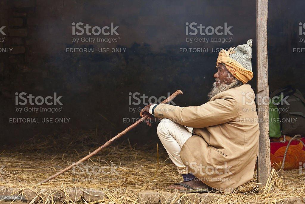 Very old poor taru man sitting in Bardia, Nepal stock photo