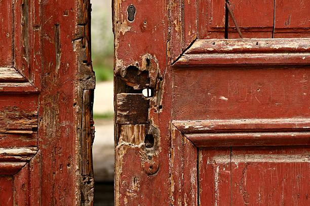Very old red door stock photo