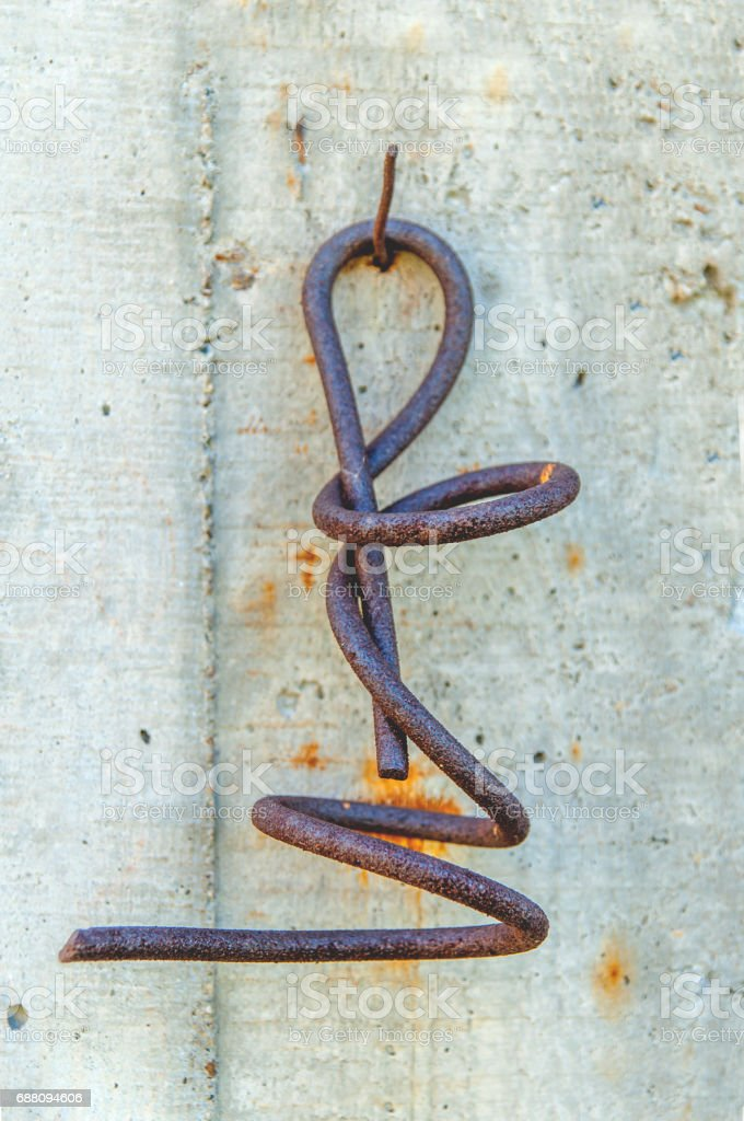 Very old rusty iron twist sprial stock photo