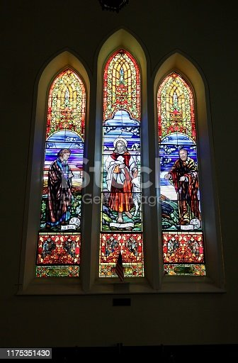 Very old stained glass window in a church of Jesus the Good Shepherd