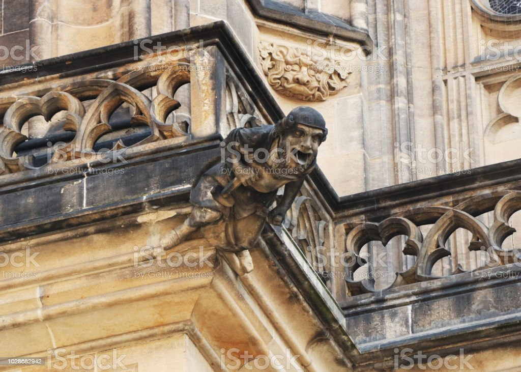 A very old statue on part of prague castle in czech republic in europe. Decoration on balcon. stock photo