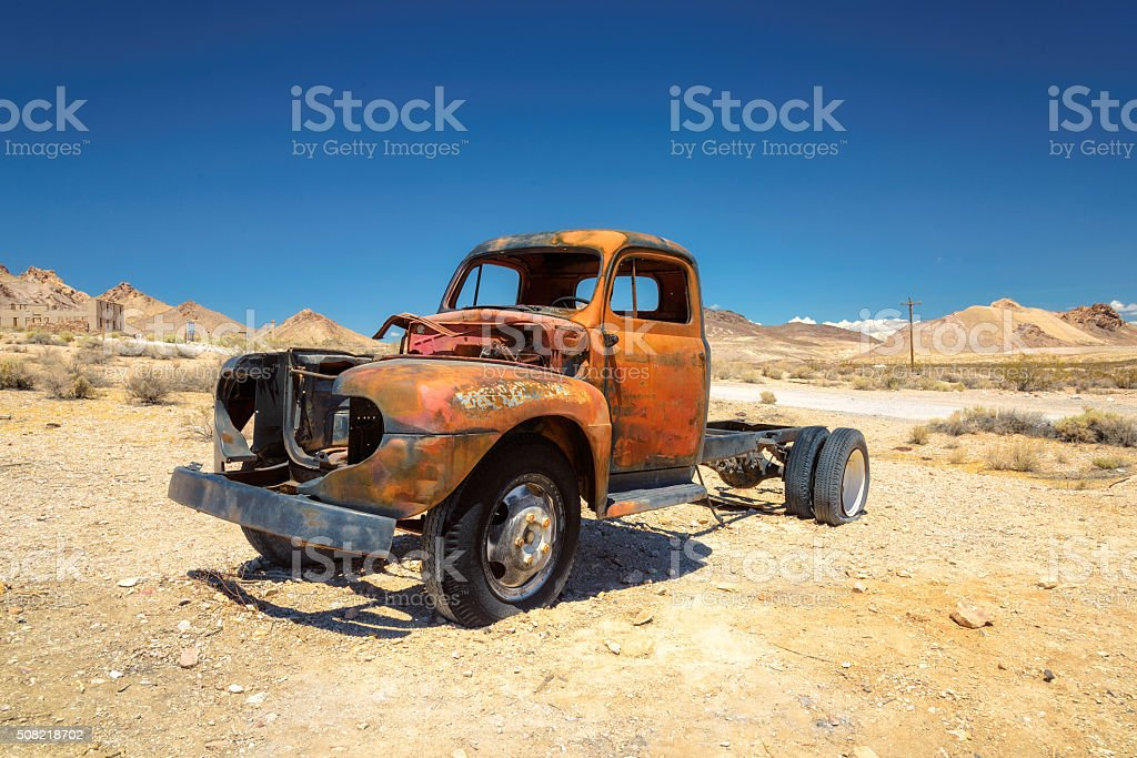 Very old vintage and rusty truck in Ghost town stock photo