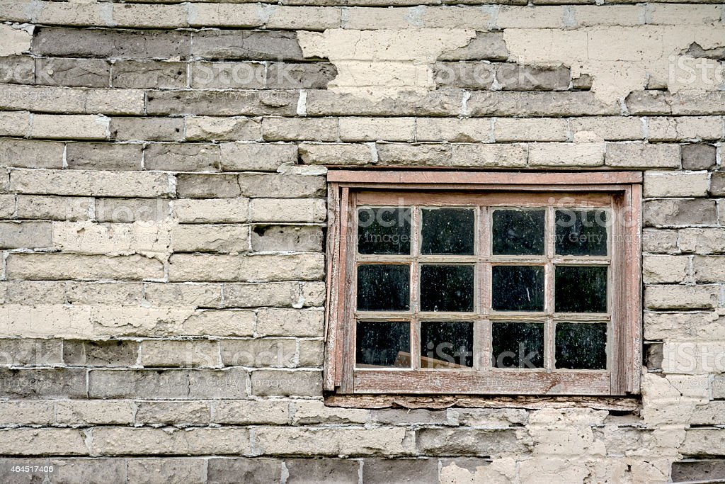 Very old window in the side of a farm house stock photo