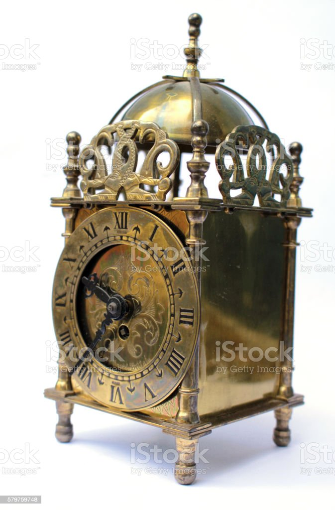 Very Ornate Brass Carriage Clock on white background stock photo
