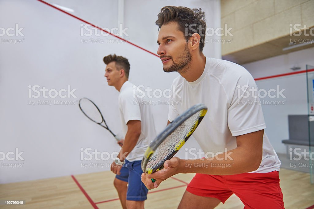 Very pensive men on the squash court stock photo