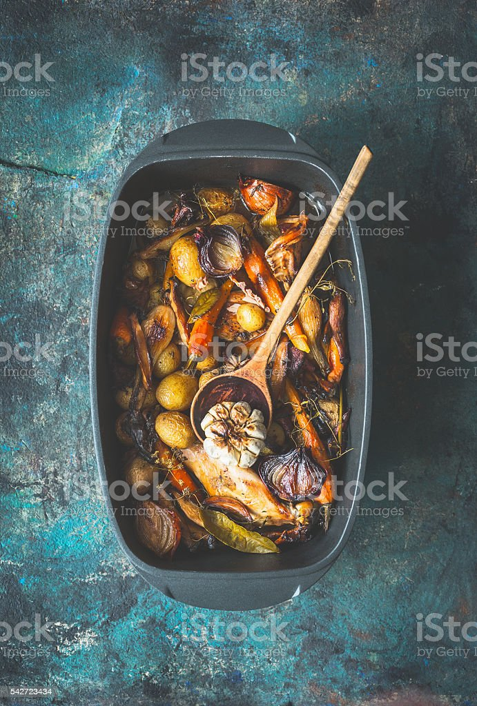 Very rustic roasted vegetables stew or ragout with forest mushrooms stock photo