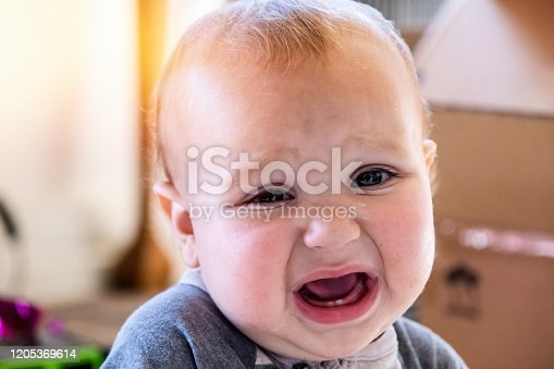 953553492 istock photo Very sad Baby boy pouting looking at the camera 1205369614