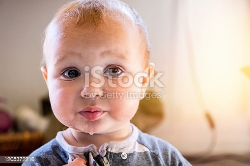 953553492 istock photo Very sad Baby boy pouting looking at the camera 1205372216