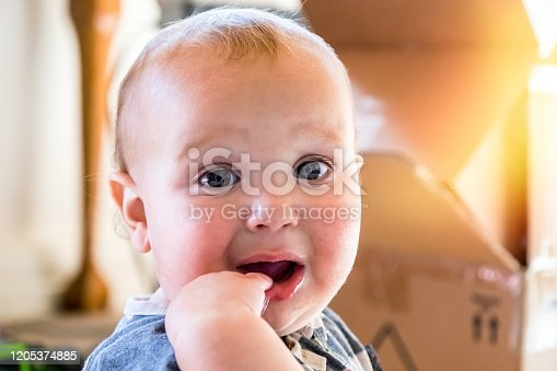 953553492 istock photo Very sad Baby boy pouting looking at the camera 1205374885