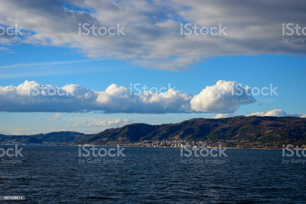 Very sharp cumulus clouds over the shore stock photo