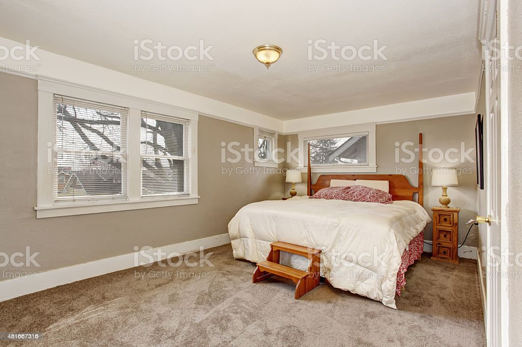 Very Simple Room With Grey Tan Walls And White Bedding Stock Photo Download Image Now Istock