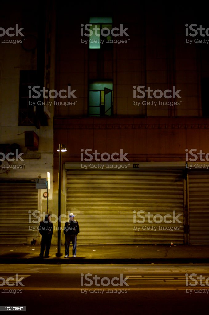 "Very Sketchy ""Two men standing under a streetlight in a bad part of downtown Los Angeles at night.  Somewhat grainy, but good that way."" Adult Stock Photo"