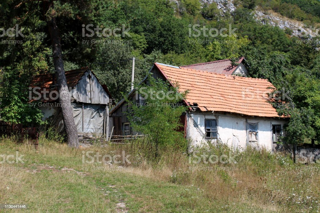 Very Small Abandoned Old Wooden Family House With Dilapidated