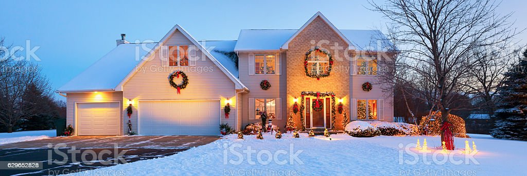 Very special holiday decorated home with Christmas lighting, snowy panorama stock photo