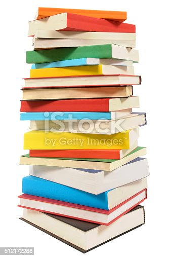 Very tall pile of books isolated on white background
