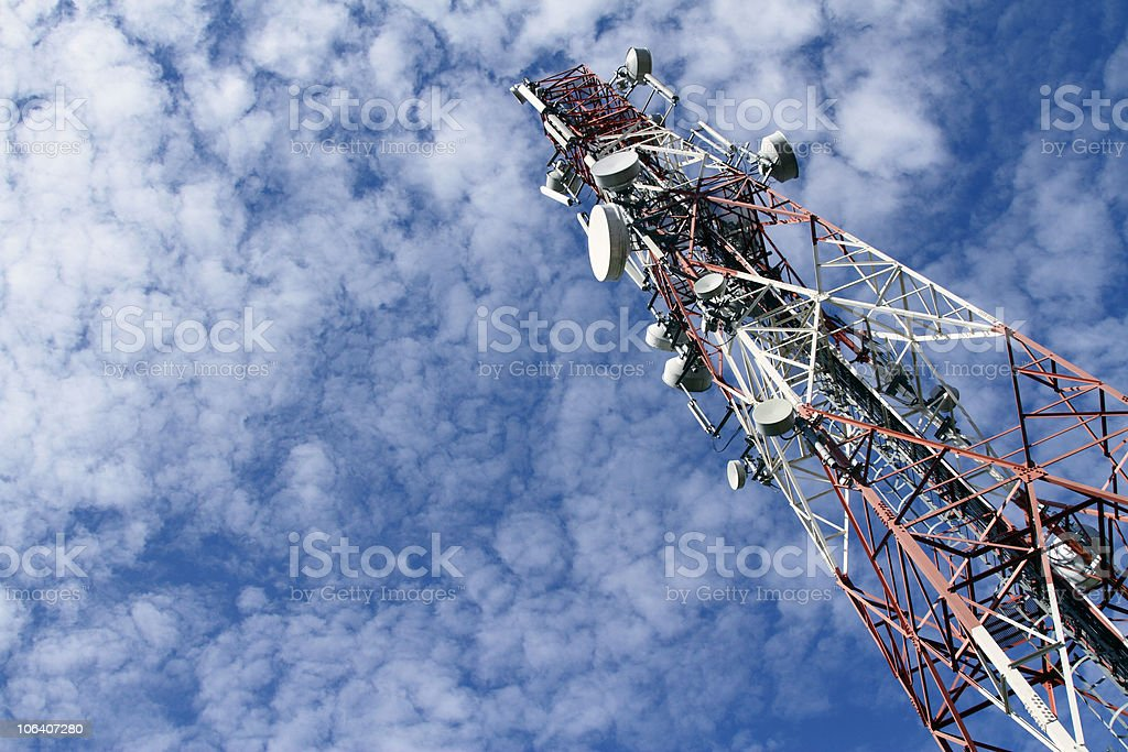 Very tall red and white telecommunications tower against sky stock photo