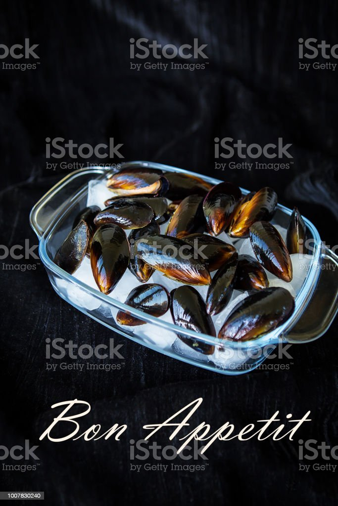 Very tasty and fresh mussels on ice cubes-the inscription of a Bon Appetit stock photo
