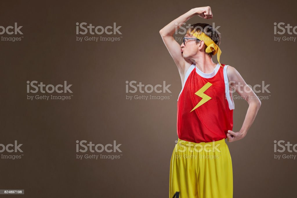 A very thin guy in sports clothes kisses his hand. stock photo