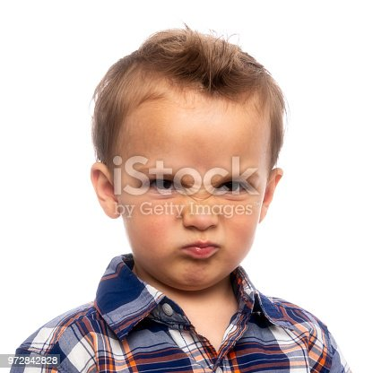 Very Upset Little boy on white background looking at the camera