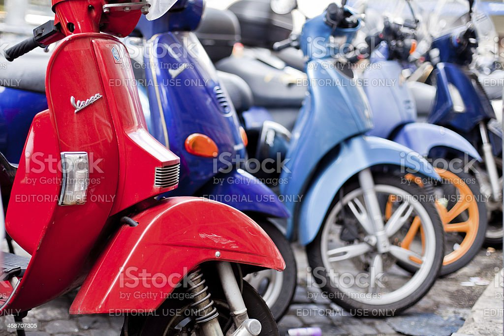 Vespa and others Scooters Parked in Rome, Italy royalty-free stock photo