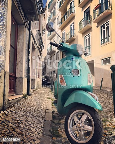 Lisbon, Portugal - May 03, 2017: Vespa parked on old Lisbon street, Portugal